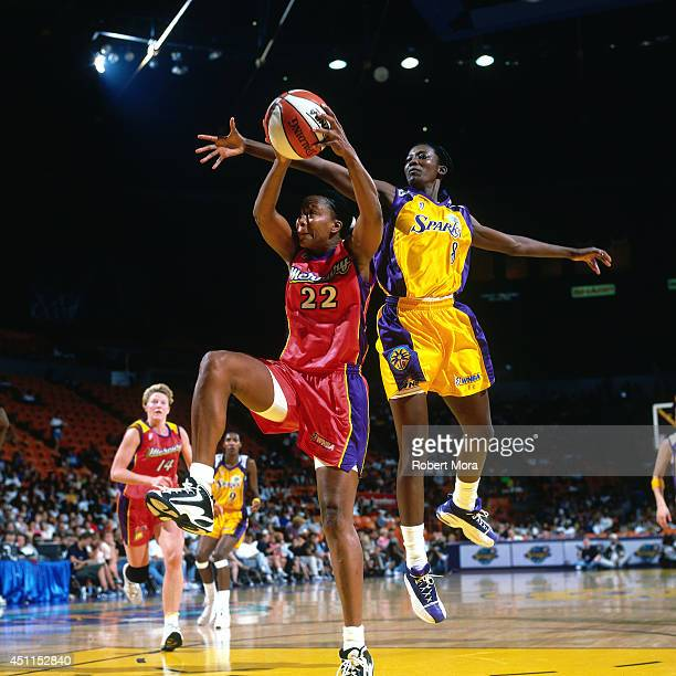 Jennifer Gillom of the Phoenix Mercury shoots against DeLisha Milton of the Los Angeles Sparks at Staples Center July 22 1999 in Los Angeles CA NOTE...