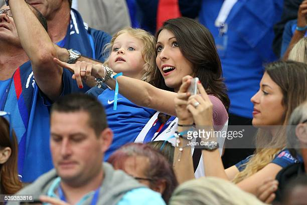Jennifer Giroud, wife of Olivier Giroud of France and their daughter Jade Giroud attend the UEFA Euro 2016 Group A opening match between France and...