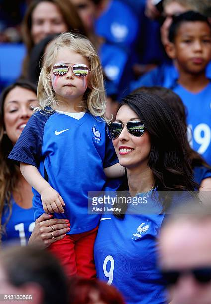 Jennifer Giroud, wife of Olivier Giroud of France holding her daughter Jade is seen in the stand prior to the UEFA EURO 2016 round of 16 match...