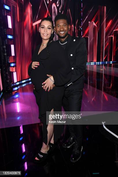 Jennifer Goicoechea and Usher attend the 2021 iHeartRadio Music Awards at The Dolby Theatre in Los Angeles, California, which was broadcast live on...