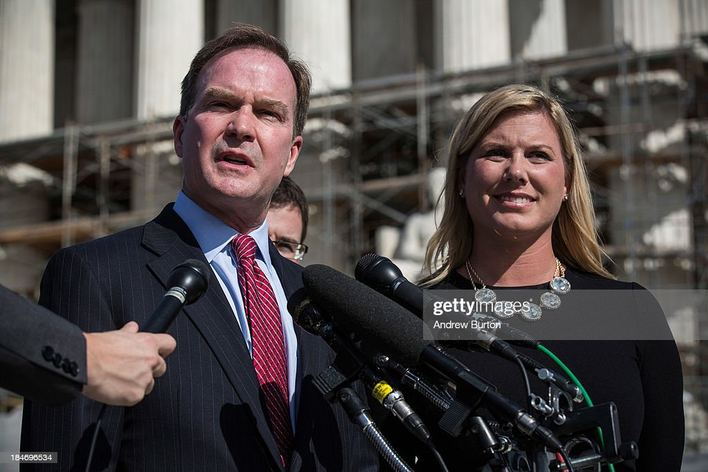 Jennifer Gratz (R), CEO of XIV Foundation, and Michigan Attorney General Bill Schuette speak during a press conference outside the Supreme Court after going before the Supreme Court in 'Schuette v. Coalition to Defend Affirmative Action' on October 15, 2013 in Washington, DC. The case revolves around affirmative action and whether or not states have the right to ban schools from using race as a consideration in school admissions. Gratz was involved in a previous Supreme Court case involving the same issues.