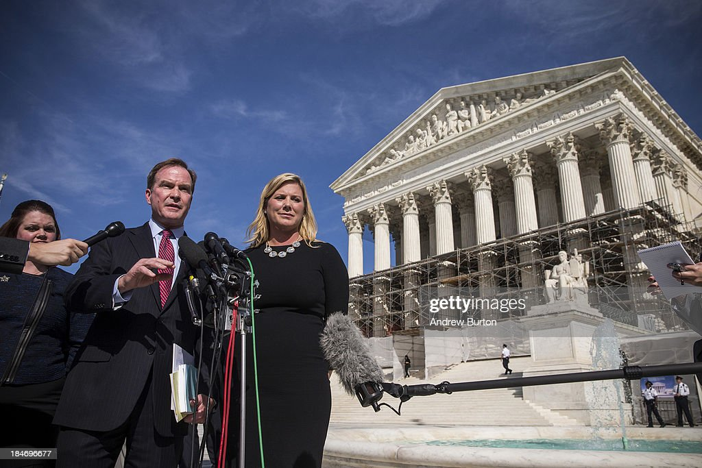 Jennifer Gratz (R), CEO of XIV Foundation and Michigan Attorney General Bill Schuette speak during a press conference outside the Supreme Court after going before the Supreme Court in 'Schuette v. Coalition to Defend Affirmative Action' on October 15, 2013 in Washington, DC. The case revolves around affirmative action and whether or not states have the right to ban schools from using race as a consideration in school admissions. Gratz was involved in a previous Supreme Court case involving the same issues.