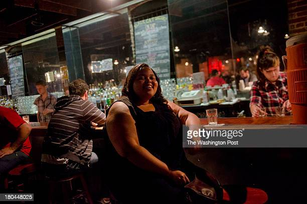 DC Jennifer Green takes a seat at the bar during the Identity Crisis Comedy Showcase at the Black Cat nightclub on Friday August 16 2013 in...