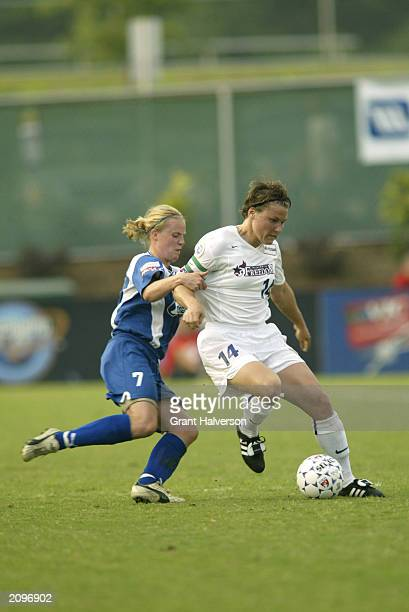 Jennifer Grubb of the Washington Freedom dribbles the ball against Unni Lehn of the Carolina Courage during a WUSA game at SAS Stadium on June 11...