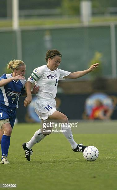 Jennifer Grubb of the Washington Freedom plays the ball against Unni Lehn of the Carolina Courage during a WUSA game at SAS Stadium on June 11 2003...
