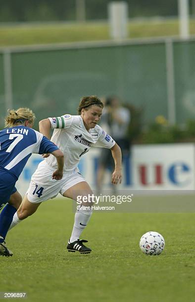 Jennifer Grubb of the Washington Freedom runs for the ball against Unni Lehn of the Carolina Courage during a WUSA game at SAS Stadium on June 11...