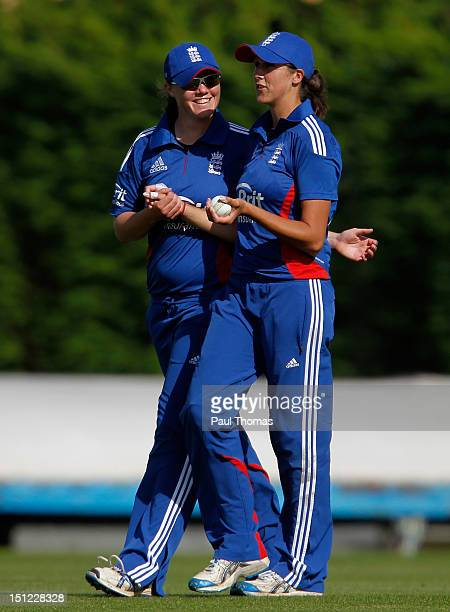 Jennifer Gunn of England celebrates with team mate Anya Shrubsole after taking a wicket during the first NatWest Women's International T20 cricket...