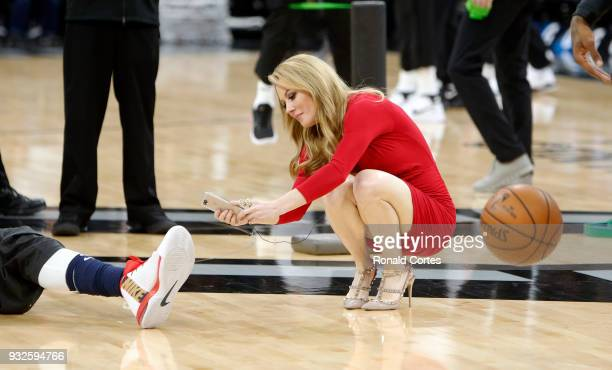 Jennifer Hale photographs the shoe of Anthony Davis of the New Orleans Pelicans who had an inscription to honor the passing of owner Tom Benson...