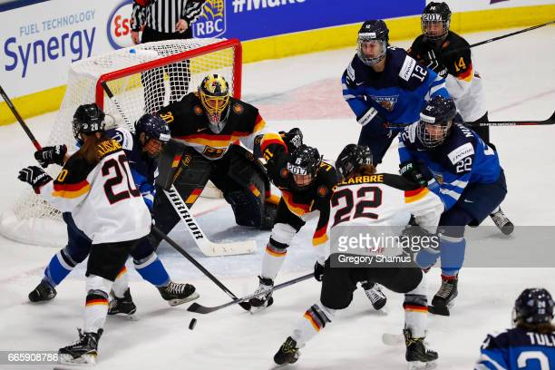 Jennifer Harss of Germany tries to keep an eye on the puck during the first period in the bronze medal game at the 2017 IIHF Woman's World...