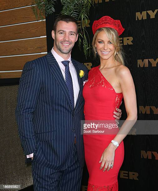 Jennifer Hawkins and Kris Smith attend the Myer marquee during Melbourne Cup Day at Flemington Racecourse on November 5 2013 in Melbourne Australia