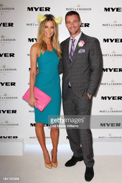 Jennifer Hawkins and Kris Smith pose inside the Moet and Chandon Marquee during Spring Champion Stakes Day at Royal Randwick on October 12 2013 in...
