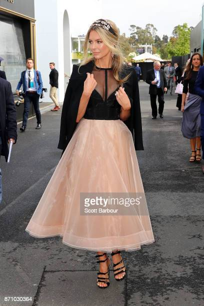 Jennifer Hawkins arrives poses on Melbourne Cup Day at Flemington Racecourse on November 7 2017 in Melbourne Australia