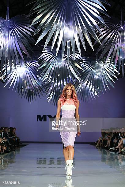 Jennifer Hawkins showcases designs by Alex Perry during the Myer Spring Summer 2014 Fashion Launch at Carriageworks on August 7 2014 in Sydney...