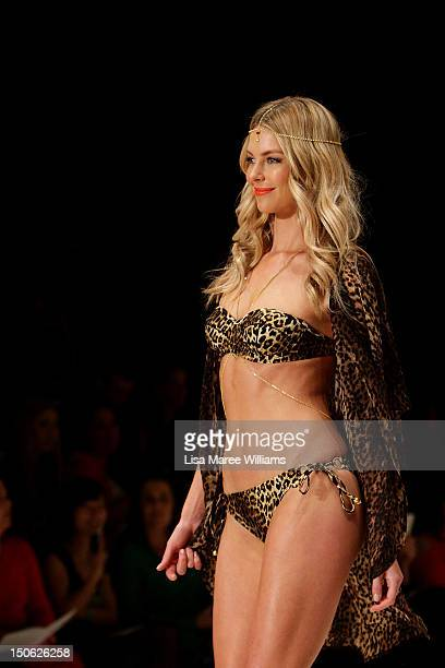 Jennifer Hawkins showcases designs by Cozi during the MYER Collection show as part of the the MercedesBenz Fashion festival Sydney 2012 at Sydney...