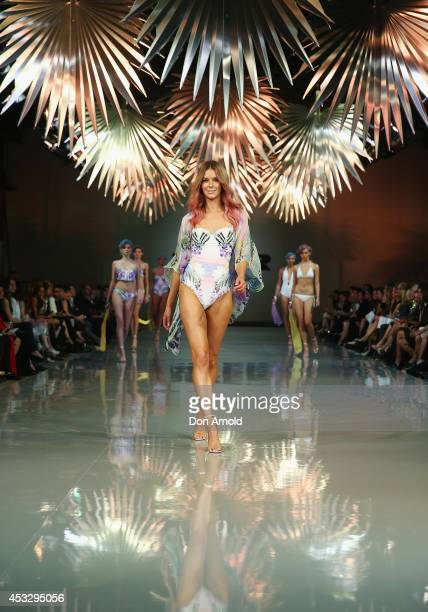 Jennifer Hawkins showcases designs by Cozi during the Myer Spring Summer 2014 Fashion Launch at Carriageworks on August 7 2014 in Sydney Australia