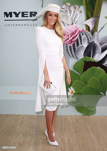 Jennifer Hawkins wearing Alex Perry and millinery by Ann Shoebridge poses at the Myer Marquee on Derby Day at Flemington Racecourse on October 31...