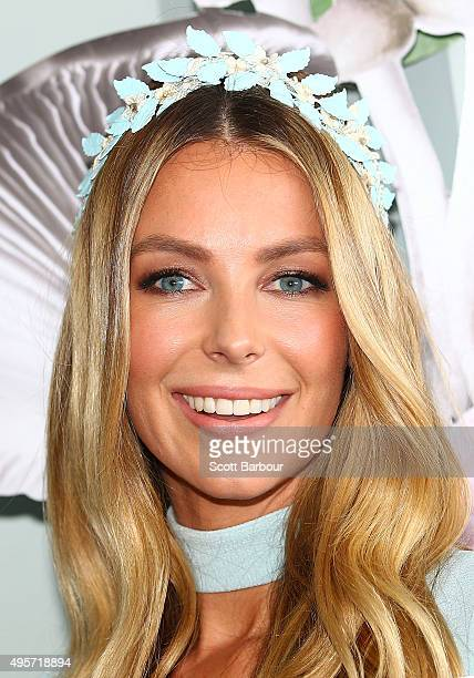 Jennifer Hawkins wearing Daniel Avakian and millinery by Viktoria Novak poses at the Myer Marquee on Oaks Day at Flemington Racecourse on November 5...