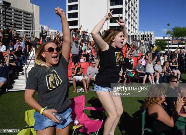 Jennifer Heck and her daughter Mady Heck, both of Nevada, celebrate at a Vegas Golden Knights road game watch party at the Downtown Las Vegas Events...