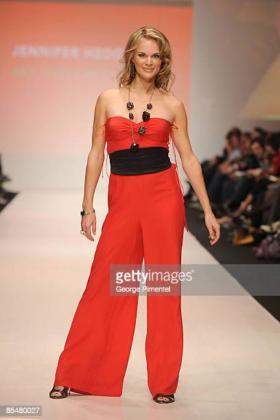 Jennifer Hedger walks the runway wearing a Jay Godfrey design for the The Heart Truth Fashion Show at LG Fashion Week at Nathan Phillips Square on...