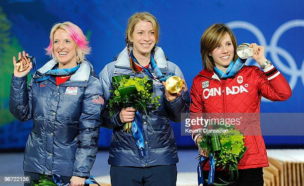 Jennifer Heil of Canada celebrates silver Hannah Kearney of United States celebrates gold and Shannon Bahrke of United States celebrates bronze...