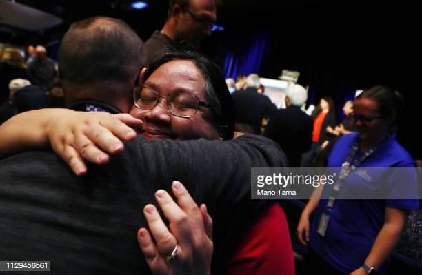 Jennifer Herman NASA Power Subsystem Operations Lead for the rover Opportunity hugs a colleague at a press conference announcing the conclusion of...