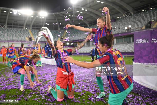 Jennifer Hermoso, Ana-Maria Crnogorcevic and Marta Torrejon of FC Barcelona celebrate with the confetti after victory in the UEFA Women's Champions...