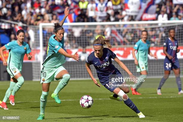 Jennifer Hermoso of Barcelona and Irene Paredes of Paris SaintGermain fight for the ball during the Women's Champions League match between Paris...