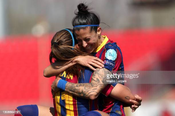 Jennifer Hermoso of FC Barcelona celebrates with Alexia Putellas after scoring their team's third goal during the First Leg of the UEFA Women's...