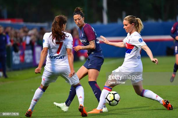 Jennifer Hermoso of PSG slips the ball between Amel Majri of Lyon and Amandine Henry of Lyon during the French Women's Division 1 match between Paris...