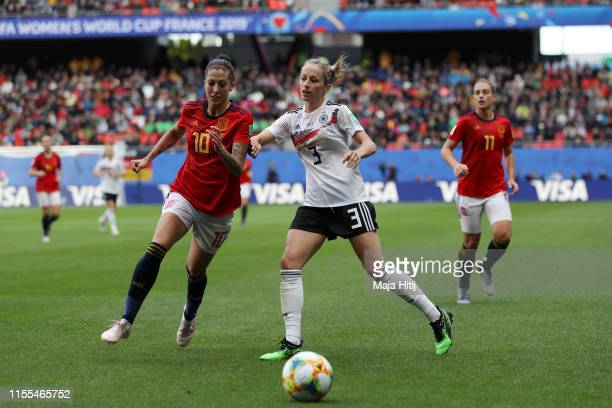 Jennifer Hermoso of Spain battles for possession with Kathrin Hendrich of Germany during the 2019 FIFA Women's World Cup France group B match between...
