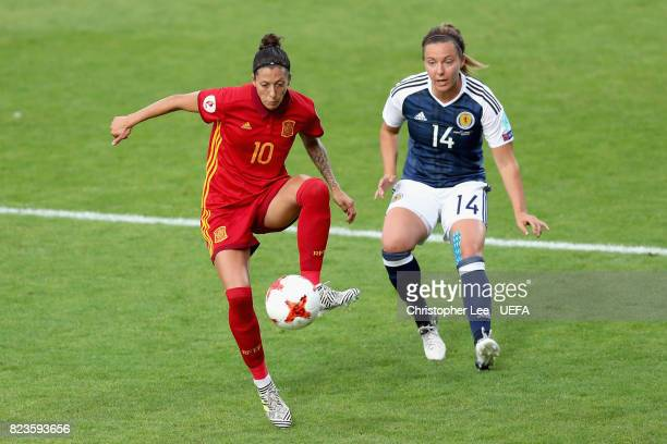 Jennifer Hermoso of Spain is put under pressure from Rachel Corsie of Scotland during the Group D match between Scotland and Spain during the UEFA...