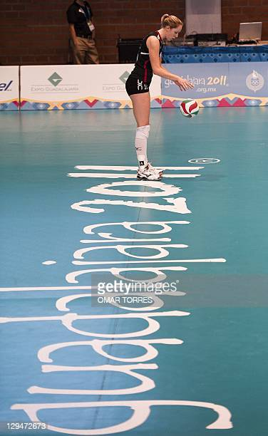 Jennifer Hinze of Canada prepares to serve during their preliminary volleyball match gainst Domincan Republic during the XVI Pan American Games in...