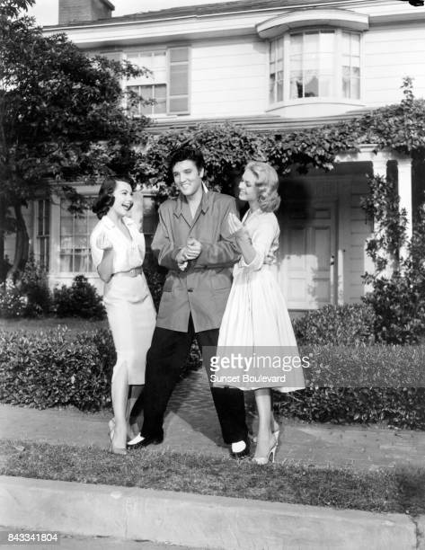 Jennifer Holden and Judy Tyler with singer and actor Elvis Presley on the set of Jailhouse Rock directed by Richard Thorpe
