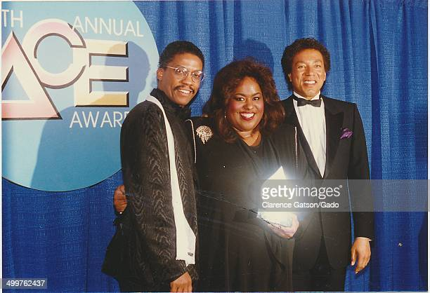 Jennifer Holliday Smokey Robinson and Herbie Hancock holding an award for Outstanding Performance in a Musical Special during the 1988 ACE awards for...
