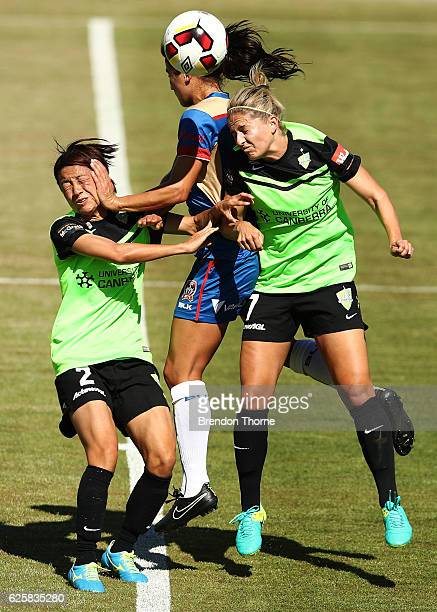 Jennifer Hoy of the Jets competes with Yukari Kinga and Ellie Brush of Canberra during the round four WLeague match between Canberra United and the...