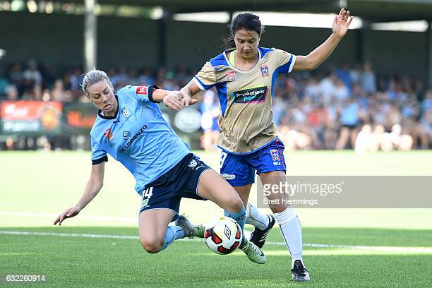 Jennifer Hoy of the Jets is tackled by Alanna Kennedy of Sydney during the round 13 WLeague match between Sydney FC and the Newcastle Jets at Lambert...
