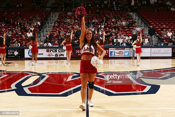 Jennifer Hoy of the Loyola Marymount Lions Cheer Team performs during the first half of the game against the Pepperdine Waves at Gersten Pavilion on...