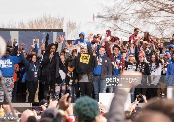 Jennifer Hudson performs with students and activists from the Stoneman Douglas High School in Parkland during March For Our Lives on March 24 2018 in...