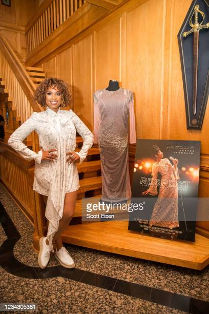 """Jennifer Hudson poses with a dress worn by Aretha Franklin during the """"RESPECT"""" reception on July 29, 2021 in Edgartown, Massachusetts."""