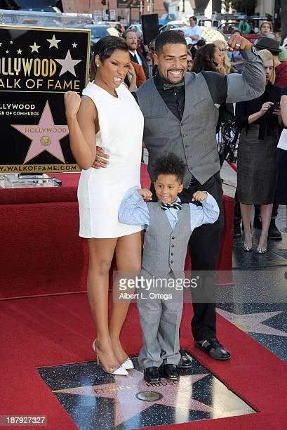 Jennifer Hudson poses with David Daniel Otunga Sr and David Daniel Otunga Jr as she is honored on The Hollywood Walk of Fame on November 13 2013 in...