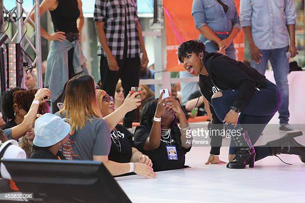 Jennifer Hudson takes photos with fans between songs as she performs on NBC's 'Today' show at Rockefeller Plaza on August 19 2014 in New York City
