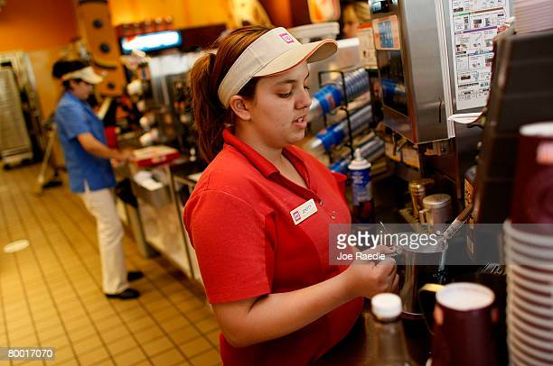 Jennifer Iglesis makes a 99 cent Dunkin' Donuts latte February 26 2008 in Miami Florida On the same day that Dunkin' Donuts offered their 99 cent...