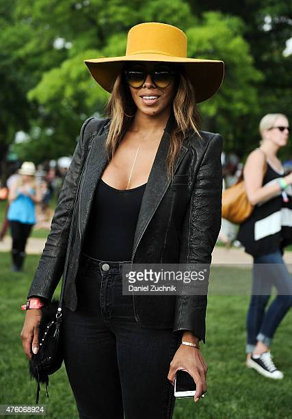 Jennifer is seen wearing a Haider Ackerman jacket Brixol hat and Stuart Weitzman shoes during the 2015 Governors Ball Music Festival at Randall's...
