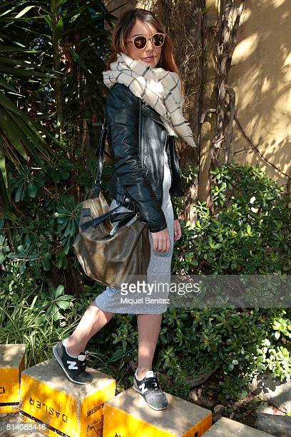 Jennifer is wearing Zara's jacket scarf handbag and sunglasses Stradivarius dress and New Balance trainers at the Palo Alto Market on March 7 2016 in...