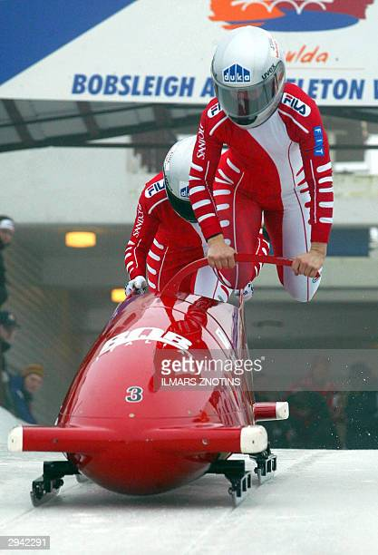 Jennifer Isacco and Gerda Weissensteiner of Italy run at the start of a women's Bobsleigh World Cup event 07 February 2004 in Sigulda. Isacco and...