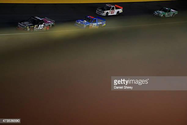 Jennifer Jo Cobb driver of the POWMIA/Driven2Honororg Chevrolet leads a pack of trucks during the NASCAR Camping World Truck Series North Carolina...
