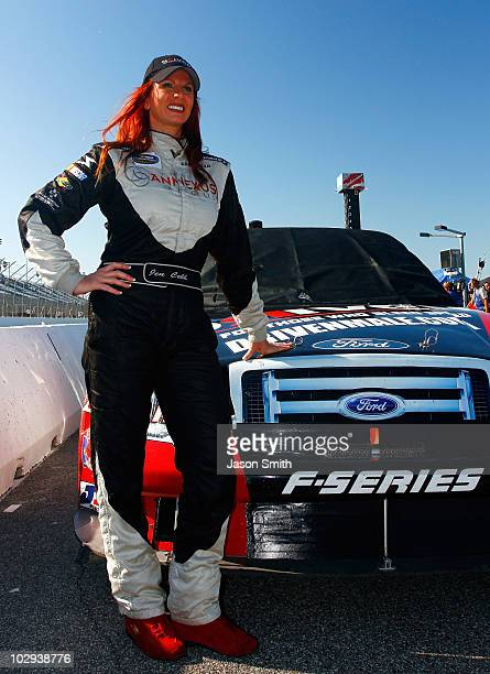 Jennifer Jo Cobb poses beside the drivenmalecom Ford during qualifying for the NASCAR Camping World Truck Series CampingWorldcom 200 at Gateway...