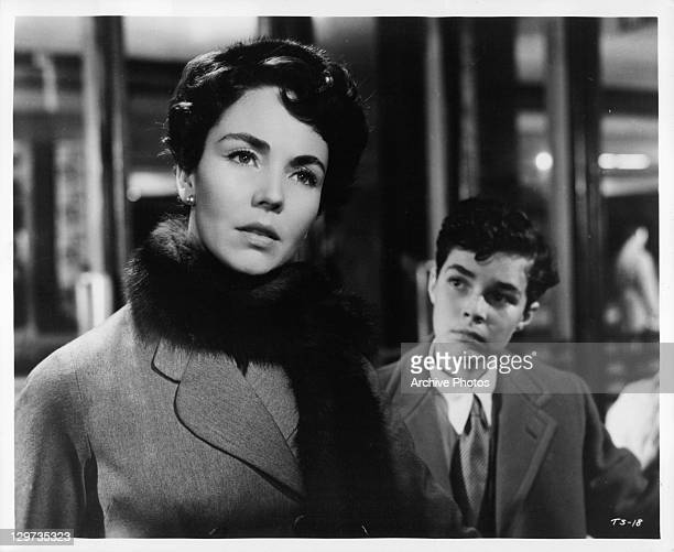 Jennifer Jones looking ahead with Dick Beymer in the background in a scene from the film 'Indiscretion Of An American Wife' 1953