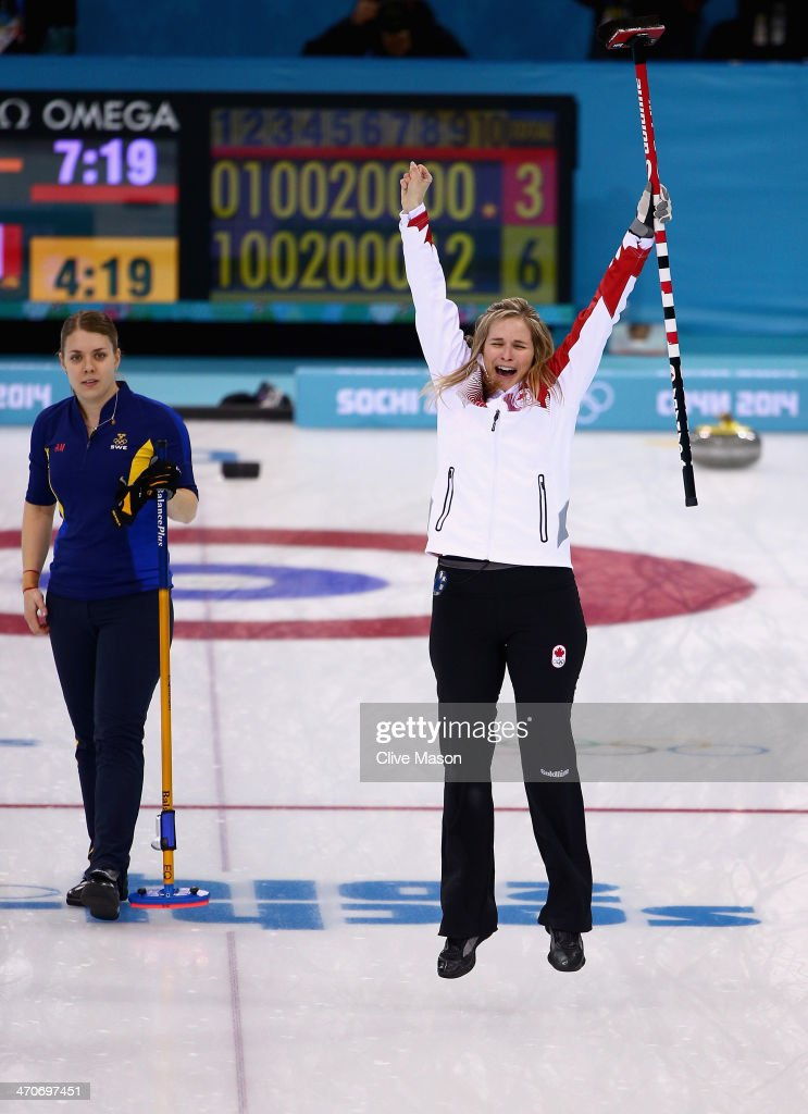 Jennifer Jones of Canada celebrates after placing a stone to win the gold medal while Maria Wennerstroem looks on during the Gold medal match between Sweden and Canada on day 13 of the Sochi 2014 Winter Olympics at Ice Cube Curling Center on February 20, 2014 in Sochi, Russia.
