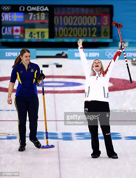 Jennifer Jones of Canada celebrates after placing a stone to win the gold medal while Maria Wennerstroem looks on during the Gold medal match between...